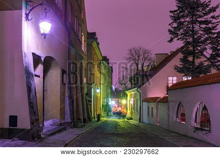 Beautiful Street In Old Town During Evening Blue Hour, Warsaw, Poland.