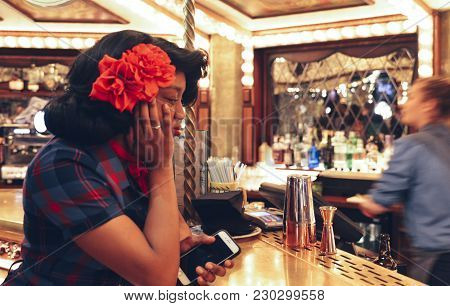 London, Uk - Mar 6, 2018: Young Afro 1950s Dressed Woman At The Bar Counter Of A Aright Carnival Fai
