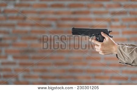 Woman's Hand Holding A Pointing Gun