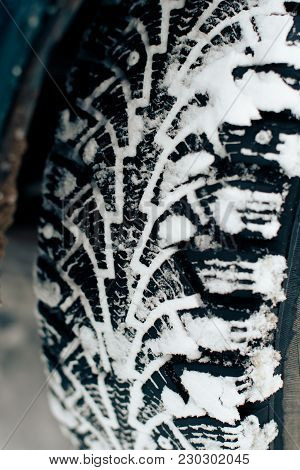 Winter Tire Protector With Spikes Close-up In The Snow 1