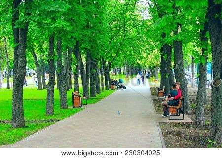 Chernihiv / Ukraine. 08 May 2017: Beautiful City Park With Nice Promenade Path Benches And Big Green