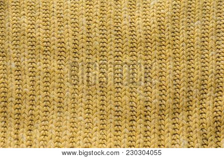 Texture of Yellow Knitted Sweater with Regular Pattern. Knit Texture Blank Background.