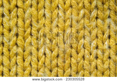 Yellow Knit Texture Close-Up. Knit Sweater Blank Background