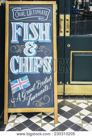 Sign On Blackboard Outside A Pub In London Promoting Their Ultimate Fish And Chips, A Great British