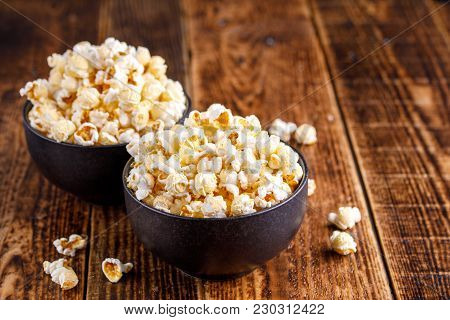 Two Exquisite Ceramic Bowls With Fresh Popcorn. Still-life On A Wooden Background.