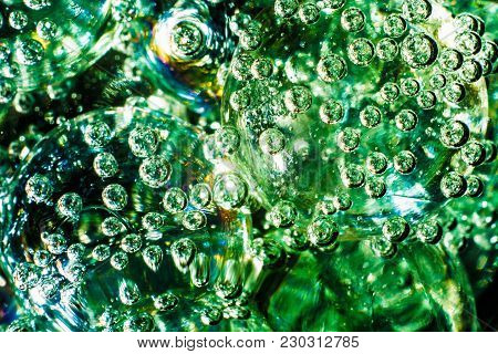 Blurred Abstract Background Based On Glass Balls And Bubbles In Water