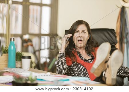 Professional Woman Reacting To Negative Phone Conversation