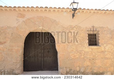 Wooden Door And Shutter On Stone Building In The Village Of Belmonte, Province Of Cuenca, Spain.