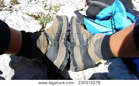 Pair Of  Boots And Blue Backpack Full Of Provisions