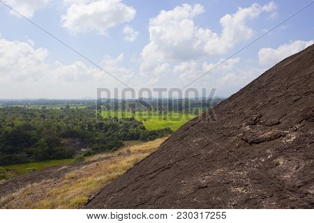 Sri Lankan Volcanic Rock Formation In Wasgamuwa National Park With Scenic Landscape And Hills Under
