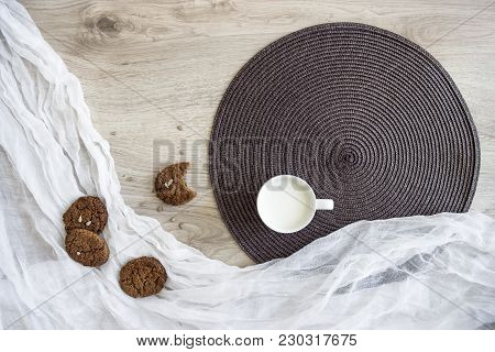 On A Wooden Table On A White And Dark Round Napkin Lie Oatmeal Cookies Sunflower Seeds Thaw A Glass