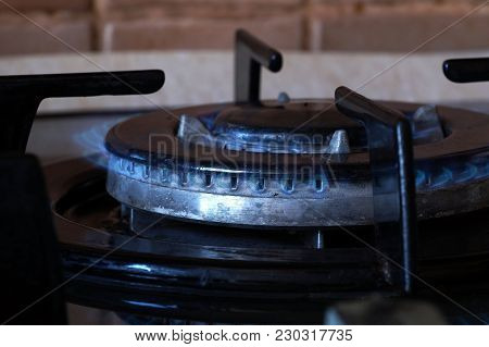 Burning Gas On A Double-row Gas Ring On The Stove