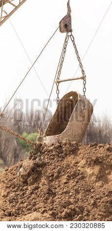 Excavator Digging A Big Bucket . In The Park In Nature