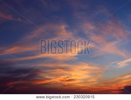 Whisps Of Clouds In A Cotton Candy Sky At Sunset.
