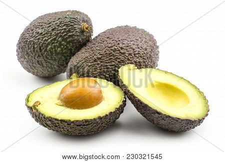 Avocado Set Isolated On White Background Two Ripe Green Brown Alligator Pears And One Cut In Section