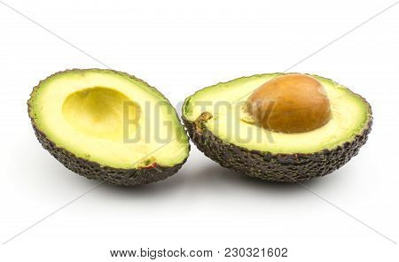 Sliced Alligator Pear (green Brown Avocado) Isolated On White Background Two Halves With A Seed