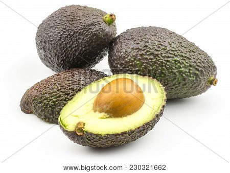 Two Avocado And Two Halves Isolated On White Background Ripe Green Brown Alligator Pear