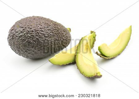 One Avocado And Three Slices Isolated On White Background Ripe Green Brown Alligator Pear