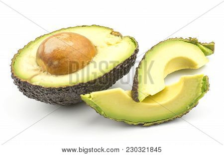 Avocado Two Fresh Cut Slices And One Half With A Seed Isolated On White Background Ripe Green Brown