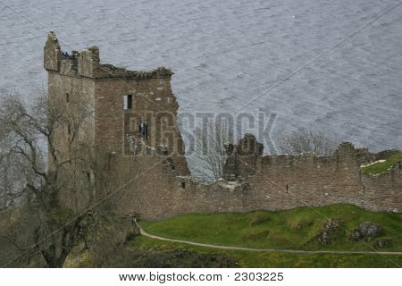 Castle Urquhart And Loch Ness In The Background