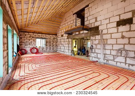 Pipefitter Installing System Of Heating Or Underfloor Heating Installation. Water Floor Heating Syst