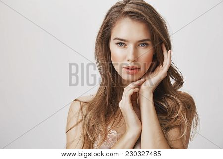Opening Up Beauty And Femininity. Portrait Of Sensual Attractive Caucasian Woman Gently Touching Cle