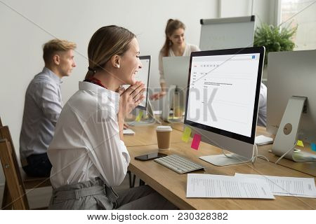 Happy Businesswoman Looking At Computer Screen Reading Email Excited By Good News Online, Smiling Wo
