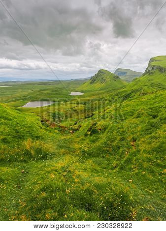 Green Hills On The Isle Of Skye As Seen From Quiraing Landslip. Two Small Lakes At The Background Wi