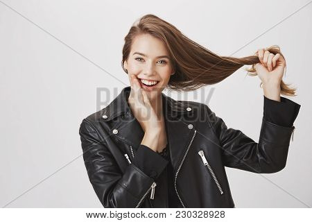 Hair Is Strong Like Herself. Portrait Of Emotive Happy European Girlfriend Pulling Hair Aside And To
