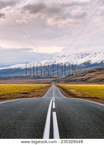 Inspirational Travel And Adventure Photography Of Inviting Road. Straight Paved Highway With White S