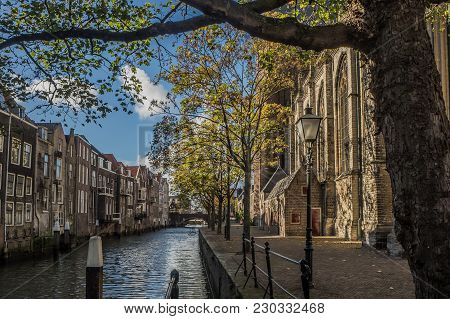 Voorstraatshaven And Grote Kerk In Dordrecht, Netherlands On A Sunny Afternoon. The Trees Have Autum