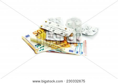 The Concept Of The High Cost Of Medicine And Large Spending On Medicaments. Pills And Euros On A Whi