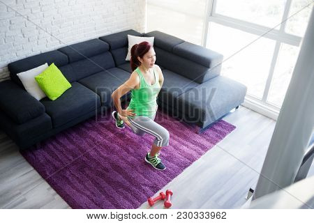 Retired Old Person, Fitness And Sports. Elderly Latina Woman Working Out At Home. Active Senior Lady