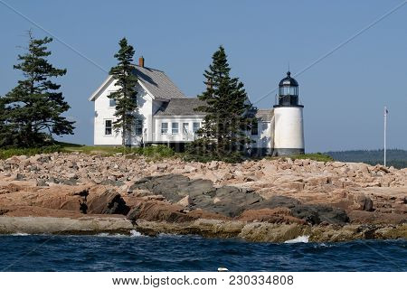 Winter Harbor Lighthouse Is An Island Beacon In Down East Maine, On A Summer Day Near Acadia Nationa