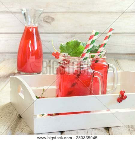 Summer Homemade Red Currant Lemonade In A Mason Jar With Decor Of Berry In Tray On Ligth Wooden Tabl