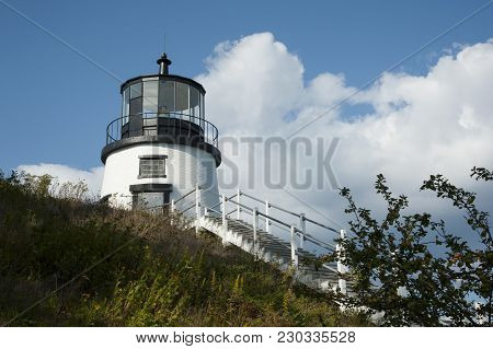 Wooden Stairway Leads Up To Owls Head Lighthouse Tower Over A Large Hill On A Warm Summer Day In Mai