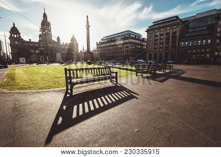 Long Benches Shadows On The George Square - The Principal Civic Square In The City Of Glasgow, Scotl
