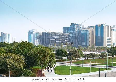 Doha City, Qatar - January 02, 2018: Green Public Park With Modern Office Buildings Near   The Popul