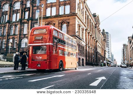 Glasgow, Scotland, Uk - March 9, 2018:  : Famous London Red Bus As A Cafe Bus On The City Street In