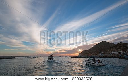 Fishermans Sunrise View Of Fishing Boat Going Out For The Day Past Lands End In Cabo San Lucas In Ba