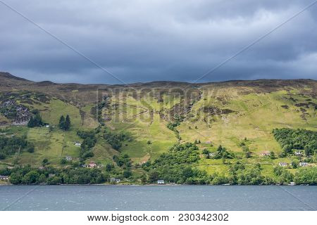 Ullapool, Scotland - June 8, 2012: Hills On West Shore Of Loch Brrom Near Ullapool Is Green And Brow