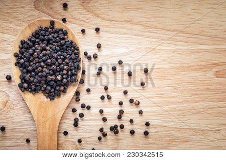 Black Peppers - Peppercorns On Wooden Background
