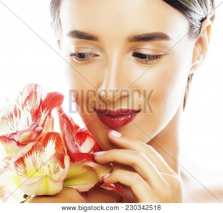 Young Pretty Brunette Real Woman With Red Flower Amaryllis Close Up Isolated On White Background. Fa
