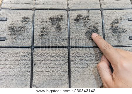 Close Up Of Dirty Dust On Air Conditioner Filter On Wood Floor In Condominium