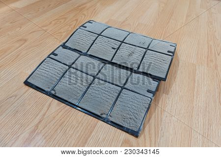 Dirty Dust On Air Conditioner Filter On Wood Floor In Condominium