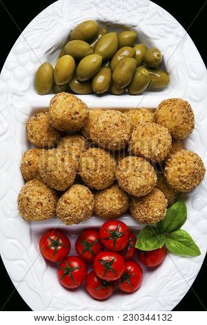 Healthy Italian Appetizer With Risotto Balls Arancini , Green Olives , Tomato And Red Winesicilian H