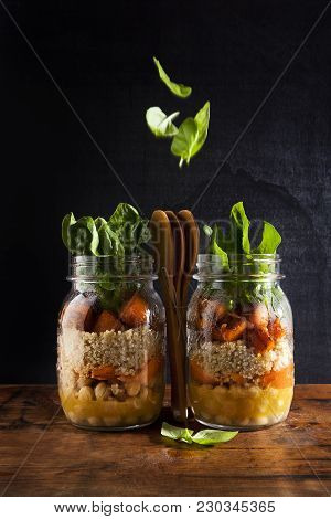 Mason Jars With Hot Salad: Chickpeas, Arrots, Quinoa, Roasted Pumpkin And Spinach. Healthy Lunch. Fa
