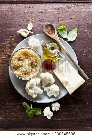 Ingredients For Risotto With Cauliflower On Wooden Background