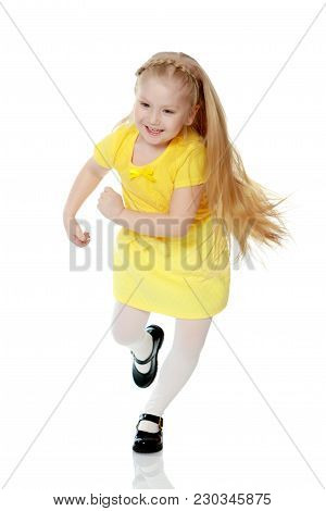A Lovely Little Round-faced Blonde Girl, With Very Long Beautiful Hair, In Short Skirts And Yellow J
