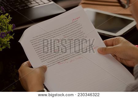 Proofreading Sheet On Working Table In Office